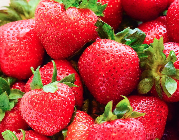 A pile of red strawberries