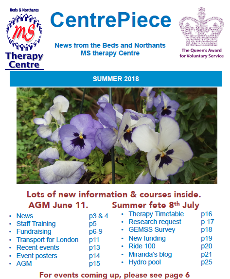 PHOTOGRAPH OF PURPLE PANSIES ON THE FRONT OF NEWSLETTER