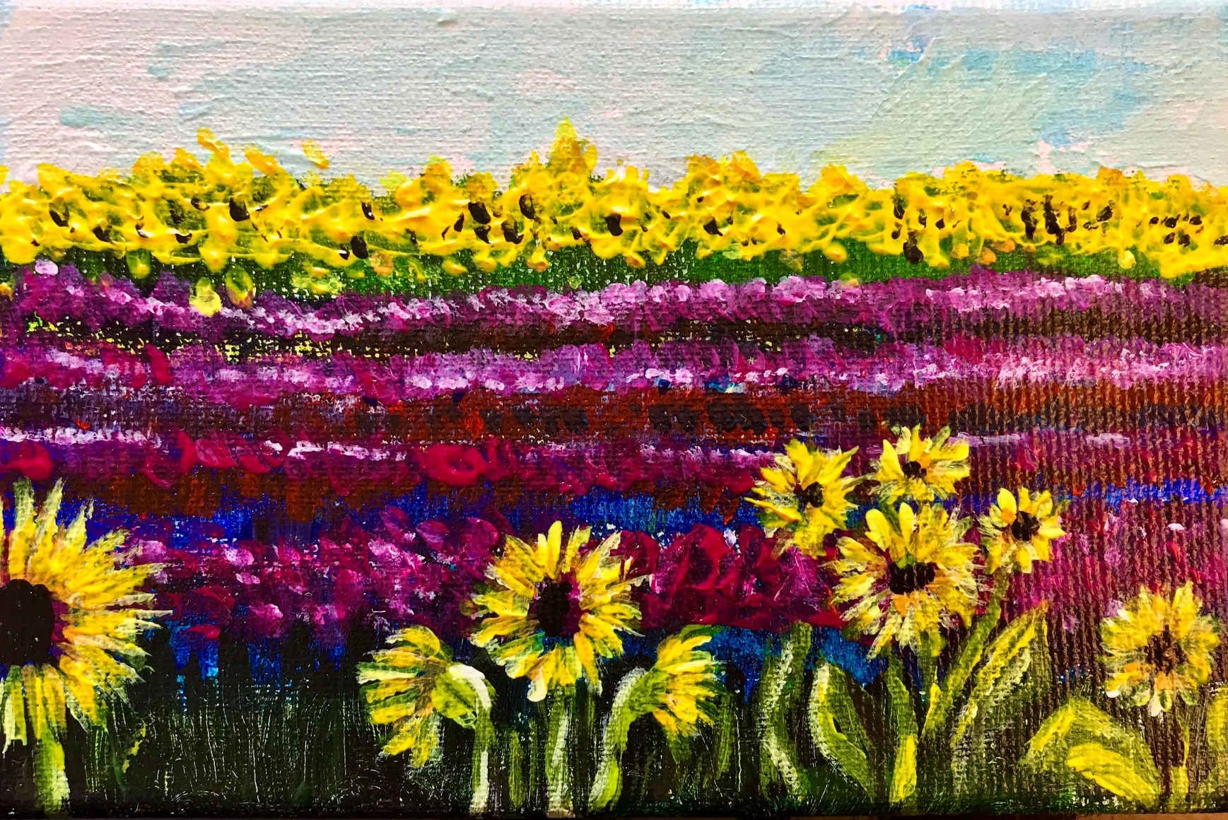 Stylised sunflowers n foreground with purple stripes representing lavender field.
